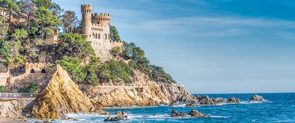 The rocky coast of Lloret de Mar featuring a castle