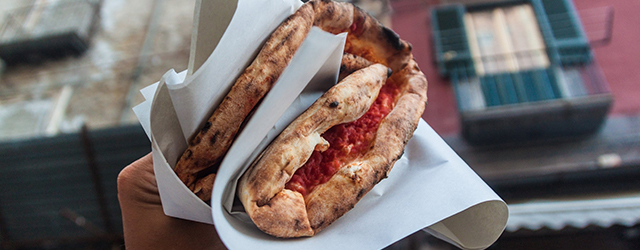 The ultimate street food: a traditional folded pizza Margherita in Naples