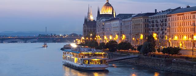 River cruise sailing through Budapest at night